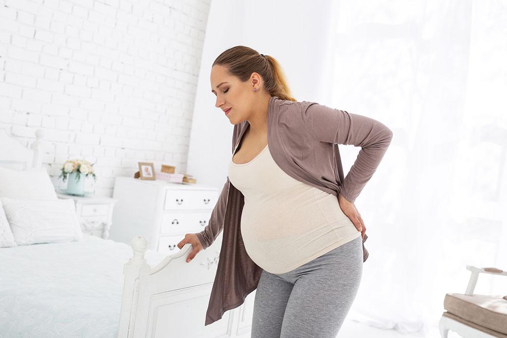 dau lung khi mang thai